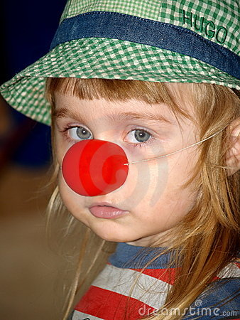 Sad girl with red clown nose