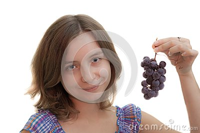 Girl with cluster of grapes