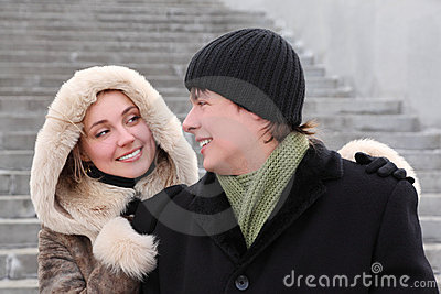Girl in coat with hood and man smiling