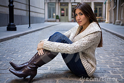 Girl on Cobblestone Street