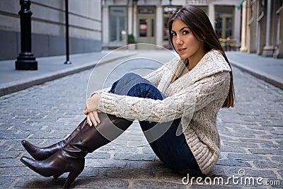 Girl on Cobblestone Street