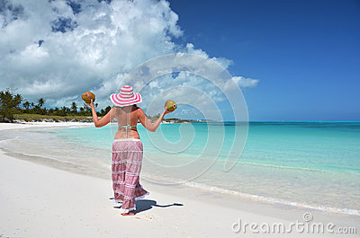 Girl with coconuts at a beach