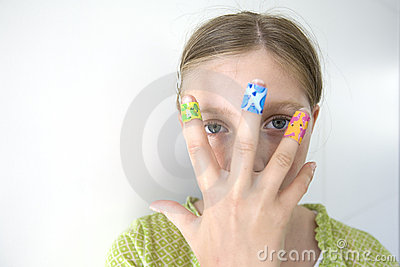Girl with coloful adhesive plasters on her fingers