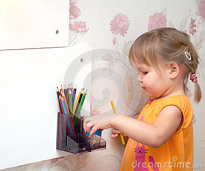 Girl with colored pencils