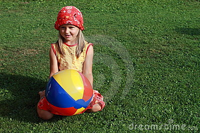 Girl with colorful ball