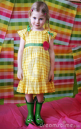 Girl in colorful dress and boots