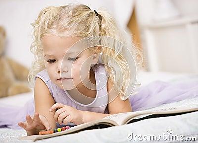 Girl Coloring in Books
