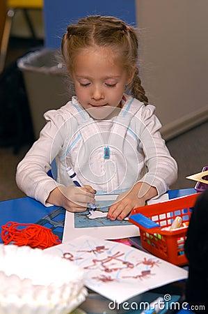 Girl Coloring At School