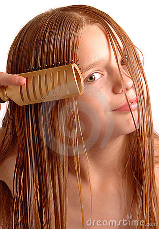 Girl combing long hair