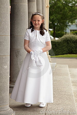 Girl in communion dress.