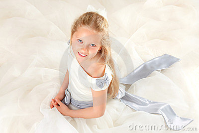 Girl in communion dress smiling