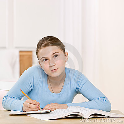 Girl concentrating on homework assignment