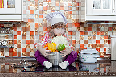 Girl cook with fresh vegetables