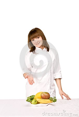 Girl cook shows fruit
