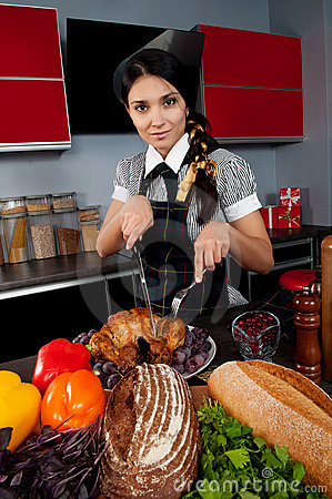 Girl cook a turkey slices