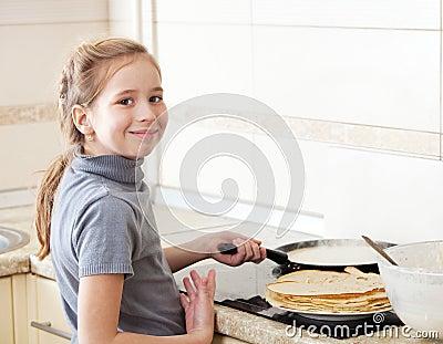 Girl cooking pancakes