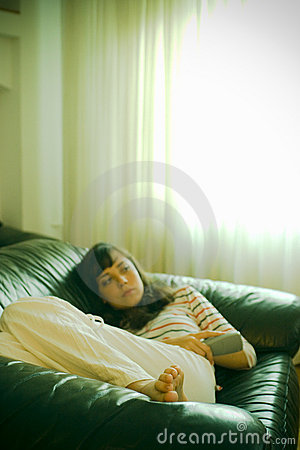 Girl on couch watching TV