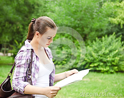 Girl in the countryside holding a map