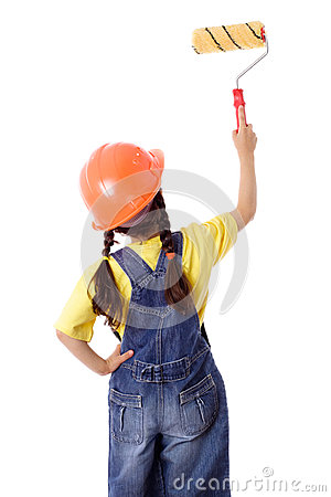 Girl in coveralls with paintroller