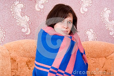 Girl is covered with a blanket