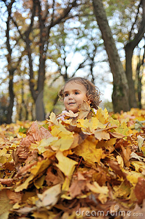 Girl covered with leaves
