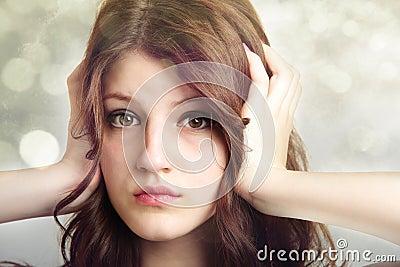 Girl covering ears not listening