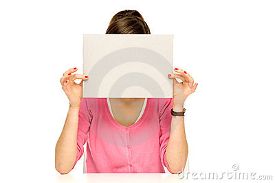 Girl covering her face with blank board