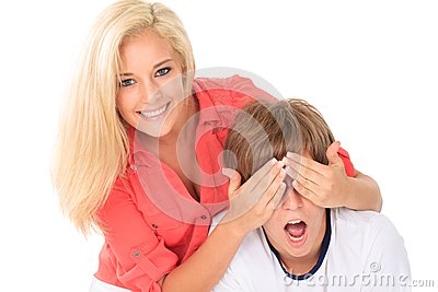 Girl covering young man s eyes