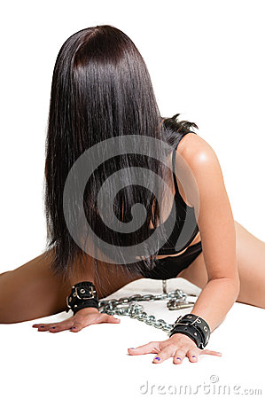 Girl crawling in shackles