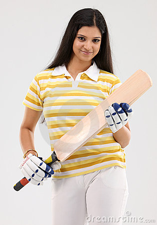 Girl with cricket bat and gloves