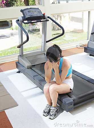 Girl cries at a sports training apparatus