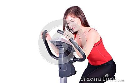 Girl on cross trainer fitness