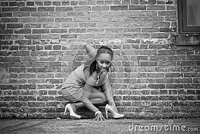 Girl crouching