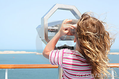 Girl on cruise liner deck and looking in binocuarl