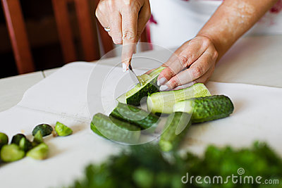 Girl cut cucumber