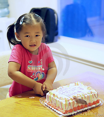 Girl Cutting Birthday Cake Royalty Free Stock Image