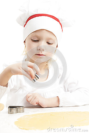Girl cutting cookies