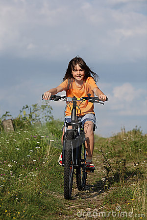 Girl cycling  in rural scenery