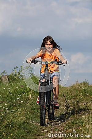 Girl cycling  in rural scenery