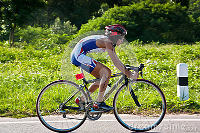 Girl  cycling in triatlon Editorial Stock Photo