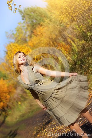 Girl dances in the autumn forest