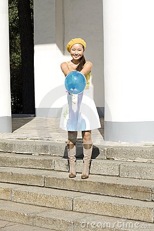 Girl dancing with baloon