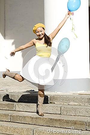 Girl dancing with baloon