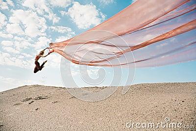 Girl dancing with big orange cloth