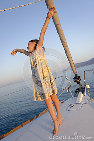 Girl dancing on deck of yacht