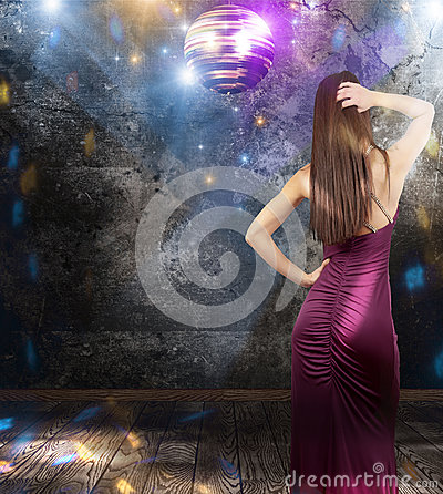 Girl dancing in a disco pub