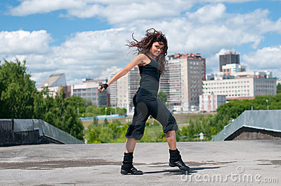 Girl dancing hip-hop over urban landscape