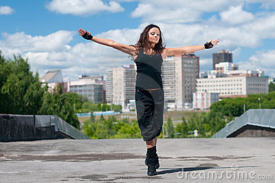 Girl dancing hip-hop over urban landscape