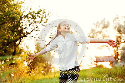 Girl dancing in the sunlight
