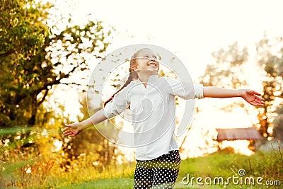 Girl dancing in the sunlight